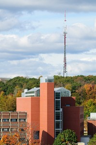 <p>The Biology/Physics Building, with the University radio tower in the background, as seen from the roof of the Student Union. Photo by Peter Morenus</p>