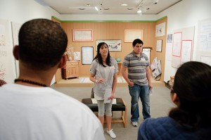 <p>Docents Julia Rockwell and Kevin Solorzano discuss an exhibition of Swedish Women's Arts with students in a First Year Experience class. Photo by Peter Morenus</p>