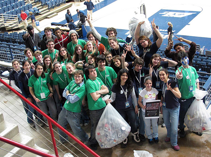 Students from the EcoHouse Learning Community students educated patrons about recycling on Green Game Day at Gampel Pavilion. Photo by EcoHouse