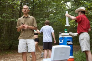 <p>Douglas Casa, left, associate professor of kinesiology, conducting a research project on dehydration in athletes. Photo by Sean Flynn</p>