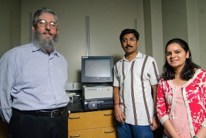 <p>From left: James Rusling, professor of Chemistry, Bhaskara Chikkaveeraiah and Ruchika Malhotra in their lab in the Chemistry building. Photo by Jessica Tommaselli</p>