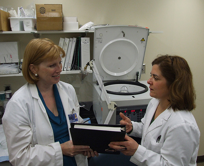 <p>Dr. Cheryl Oncken (left) is the lead author of a study of nicotine gum use by pregnant smokers published in the journal Obstetrics & Gynecology. Research assistant Pam Ferzacca (right) processed specimens for the study in the UConn Health Center's General Clinical Research Center lab. Photo by Chris DeFrancesco</p>