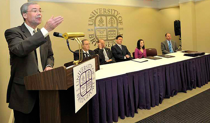 <p>Robert L. McCarthy, dean of the UConn School of Pharmacy, addresses a crowd of students, university officials, and Bridgeport city officials during the launch of a new pharmacy partnership between UConn and the University of Bridgeport. Photo by Kazuhiro Shoji</p>