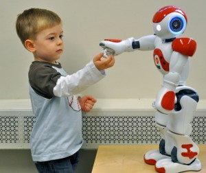 <p>Aiden Krane, age 3, with robot. Photo by Sheila Perretta</p>