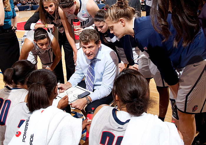 <p>Coach Gino Auriemma explains strategy. Photo by Steve Slade</p>