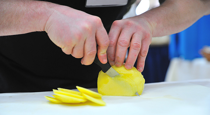 <p>A steady hand and a sharp knife come in handy during the culinary competition. Photo by Peter Morenus</p>