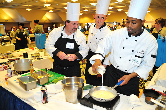 <p>Scott Chaplin, left, Charles Griffin, and  Sterling Townes of South Marketplace prepare a leak, potato and pumpkin bisque while competing with chefs from around campus in the 11th annual Culinary Competition held on January 13 at Rome Commons Ballroom. Photo by Peter Morenus</p>