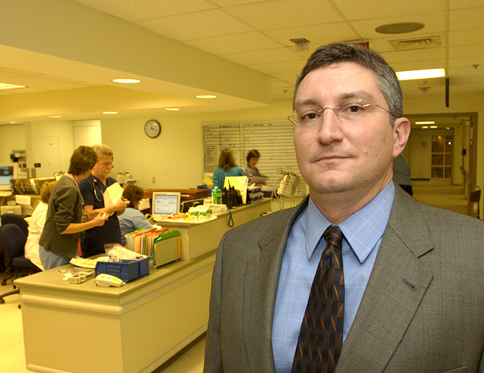 <p>Rob Aseltine associate professor of behavioral sciences and community health, at  the emergency department at the UConn Health Center. Photo by Peter Morenus</p>