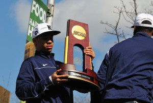 <p>Freshman Shabazz Napier shows off the NCAA championship trophy. Photo by Peter Morenus.</p>