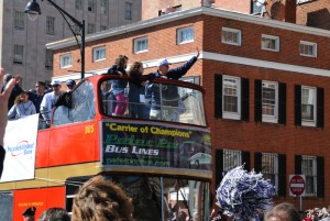 <p>The players and Coach Calhoun responded to the crowd from the top of a double-decker bus that circled from the State Capitol around Bushnell Park, down Main Street, and along Capitol Avenue.  Photo by Peter Morenus.</p>
