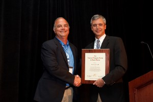 Dr. Robert Arciero (left) accepts the George D. Rovere Award for excellence in peer education from Dr. Andrew Cosagrea of the American Orthopaedic Society for Sports Medicine on July 8, 2011. (Garrett Hacking forAmerican Orthopaedic Society for Sports Medicine)