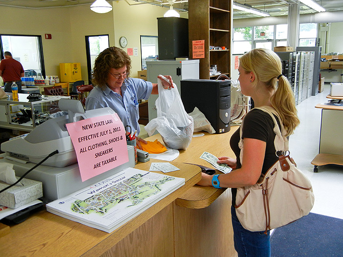 Store keeper Jeanne Saunders prepares a sale for Emma Broadhurst (CLAS '13).