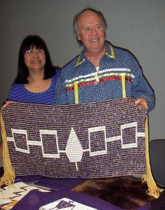Christine Abrams, left, chair of the Haudenosaunee Standing Committee on Burial Rules and Regulations, and Peter Jemison, faithkeeper for the Seneca Nation, hold a reproduction of the Haudenosaunee Hiawatha Belt.