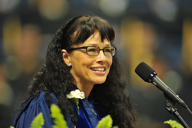 Andrea Dennis-LaVigne gives The CANR commencement address at Gampel Pavilion.