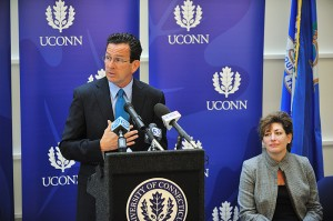 Governor Dannel P. Malloy speaks at the dedication ceremony for the new Classroom Building. Seated at right is President Susan Herbst.