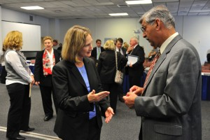 Mary Holz-Clause, left, vice president for economic development, speaks with Suman Singha, senior vice provost and vice president for research. (Peter Morenus/UConn Photo)