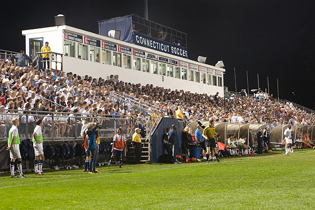 A sell-out crowd of more than 5,000 fans turned out Saturday night at Joseph J. Morrone Stadium to support the No. 2 Huskies men's soccer team as they shut out No. 12 St. John's, 2-0, in the Big East Conference opener.