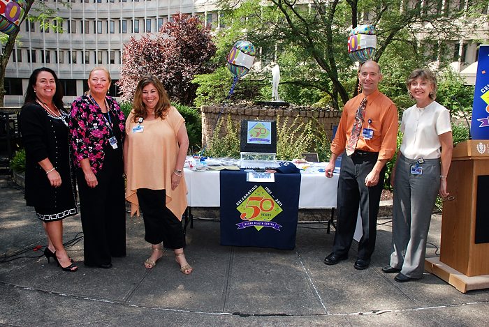 From left: Candy Pettigrew, Pam Miles, Sandy Kressner, Steve Jacobs and Patti Wawzyniecki at the time capsule ceremony on September 12, 2011. (Janine Gelineau/UConn Health Center Photo)