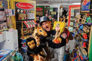 Doug Bernstein '85 (CLAS) poses with many Melissa & Doug toys. (Peter Morenus/UConn Photo)