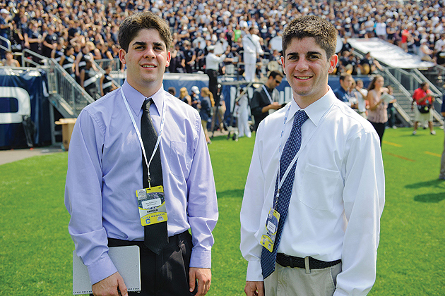 Brothers Matthew McDonough '12 (CLAS), left, and Colin McDonough '12 (CLAS) on the sidelines during a football game at Rentschler Field on September 3, 2011. (Peter Morenus/UConn Photo)
