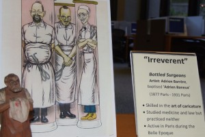 "Under the category of ""irreverent,"" French caricaturist Adrien Barrère's ""Bottled Surgeons"" is among the artwork on display in the Health Center's L.M. Stowe Library."