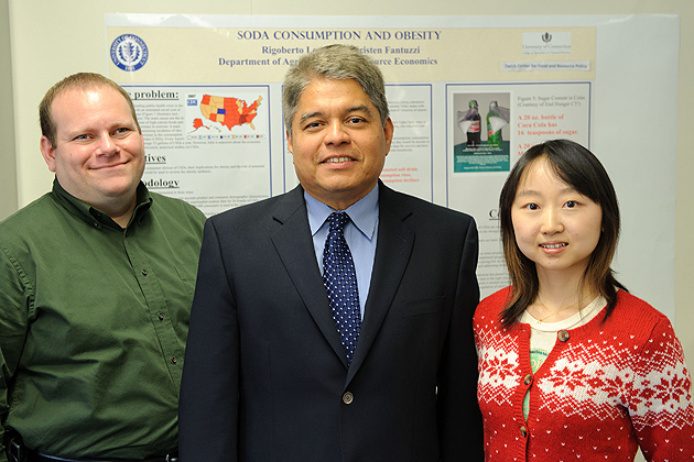 Rigoberto Lopez, center, director of the Zwick Center for Food and Resource Policy, with graduate students Adam Rabinowitz and Chen Zhu. (Peter Morenus/UConn Photo)