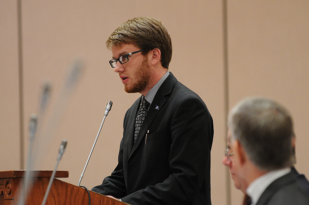 Samuel Tracy, president of the Undergraduate Student Government, speaks on the proposed tuition increase during the Board of Trustees meeting at Rome Ballroom on Dec. 19, 2011. (Peter Morenus/UConn Photo)