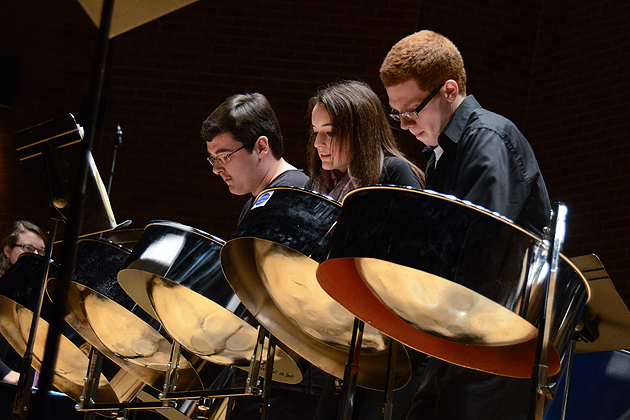 Alexander Gaffney, left,  Luci Chaplin, and Ryan Royle perform at the Steel Pan Ensemble recital held in von der Mehden Recital Hall on Dec. 4. (Ariel Dowski '14 (CLAS)/UConn Photo)