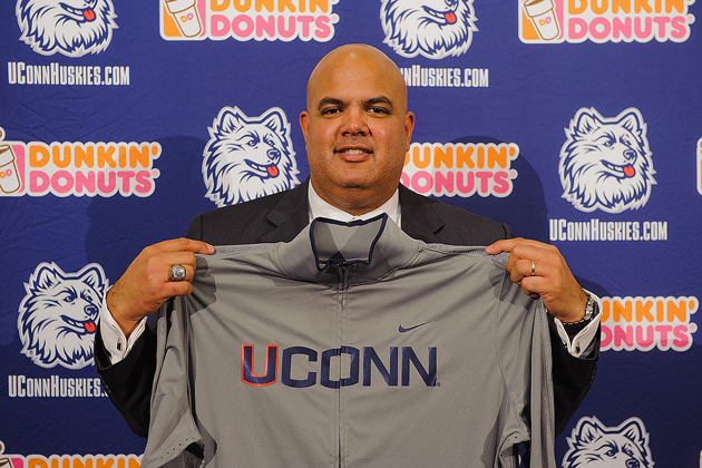 Warde Manuel holds a UConn jacket at a press conference to announce his appointment as athletic director held at the Burton Family Football Complex on Feb. 13, 2012 (Peter Morenus/UConn Photo)
