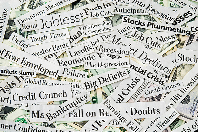 Newspaper headlines filled with news about: economy despair, crisis, money worries and dark tones about recession, depression and job losses.