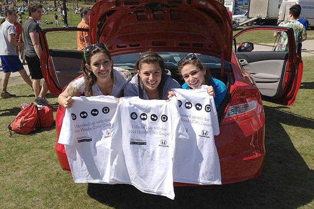 Students with T-shirts bearing the slogan developed by a marketing class.