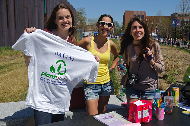 Linda Chadrys, Meg MecCabe, and Jaime Pennella of UCann Recycle take surveys and offer free UCann Recycle gear sponsored by Dasani of Coca-Cola at the UConn Earth Day Spring Fling on April 19, 2012. (Max Sinton for UConn)