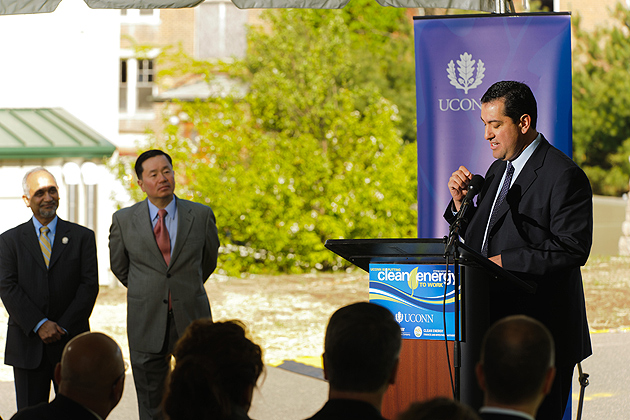 Brian Garcia, CEFIA president, speaks at a ceremony to mark the commissioning of a natural gas fuel cell outside the Center for Clean Energy Engineering on UConn's Depot campus in Storrs on April 26, 2012. At left are Prabhakar Singh, director of the Center for Clean Energy Engineering and Mun Choi, dean of engineering. (Peter Morenus/UConn Photo)