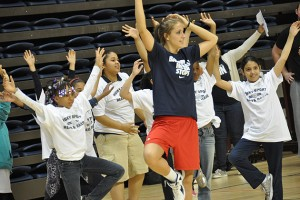 UConn student and basketball player Caroline Doty leads Read & raise participants in yoga exercises. (Shawn Kornegay/UConn Photo)