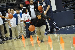 Hartford students from three elementary and middle schools who took part in the Read & Raise Initiative play basketball in Gampel Pavilion. (Shawn Kornegay/UConn Photo)