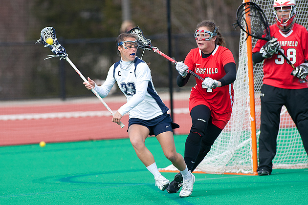 Kiersten Tupper '12 (ED) looks to pass the ball during the Huskies' win over Fairfield earlier this season. (Steve Slade for UConn)