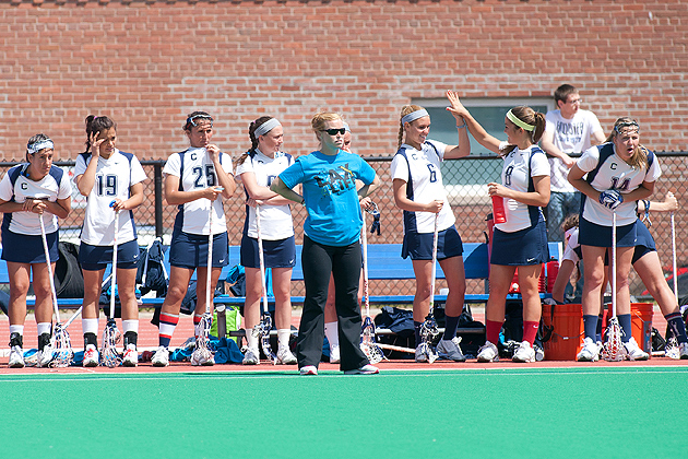 Second-year head coach Katie Woods, center, with members of the lacrosse team. The team had a winning season for the third consecutive year. (Steve Slade '89 (SFA) for UConn)