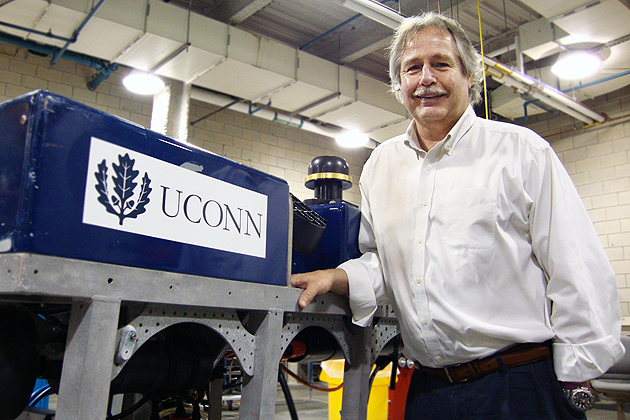 "Ivar Babb, director of the Northeast Undersea Research Technology and Education Center at UConn, with ""Hela,"" a submersible vessel that will take high-resolution photos of the Long Island Sound seafloor. (Christine Buckley/UConn Photo)"