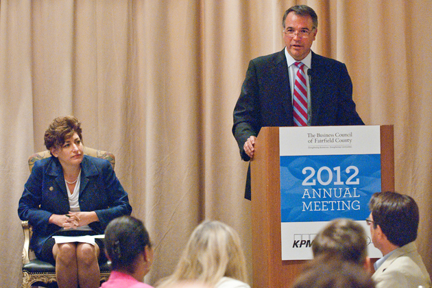 Kenneth Seel, office managing partner of KPMG LLP's Stamford office, addresses the annual meeting of The Business Council of Fairfield County, as President Susan Herbst looks on. (Business Council of Fairfield County Photo)