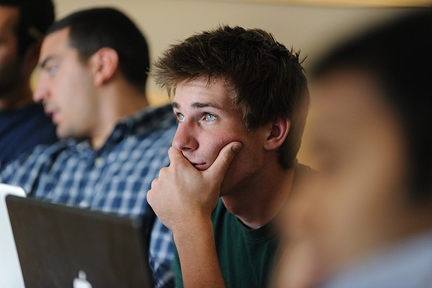Tom Bachant '13 (ENG) listens to a mentor during an inQbator training session. (Peter Morenus/UConn Photo)