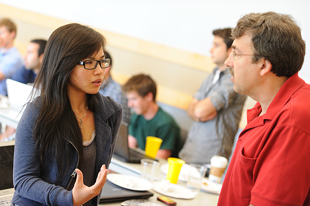 Jolina Li '12 (BUS), left, speaks with UConn's lead mentor Eric Knight during a meeting of the iQ inQbator program at the Student Union on June 13, 2012. (Peter Morenus/UConn Photo)
