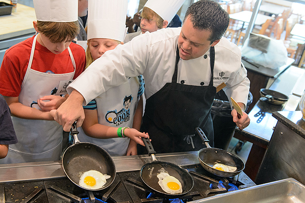Rob Landophi, manager of culinary development for Dining Services teaches children how to cook eggs during UCann Cook Camp held at Gelfenbien Commons on July 25, 2012. (Peter Morenus/UConn Photo)