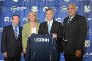 "Rex Hough, regional vice president of IMG Campus, left, Lisa Lewis, executive director of the UConn Alumni Association, Jerry Plush, president and CEO of Webster Bank, and Warde Manuel, UConn's director of athletics, at an event held at Centennial Alumni House to announce a major agreement to make Webster Bank ""The Official Bank of UConn"" on July 26, 2012. (Peter Morenus/UConn Photo)"