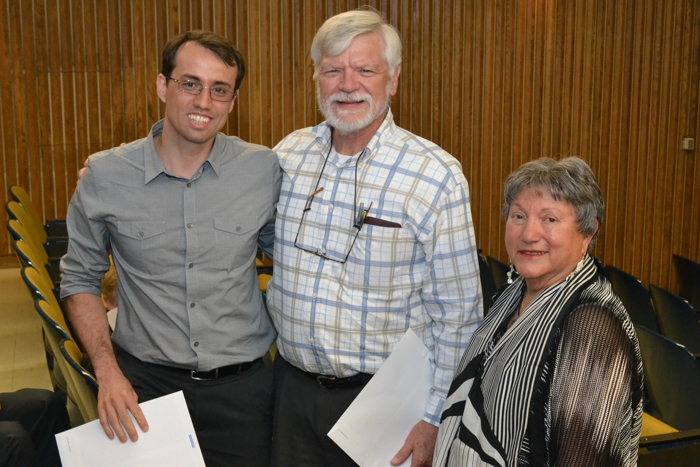 Auxiliary Facilitator Irene Engel (right) and dental professor Art Hand present a scholarship to periodontology resident Michele Furtado Araujo (left) at the Auxiliary's 2012 annual meeting on June 21, 2012. (Chris DeFrancesco/UConn Health Center Photo)