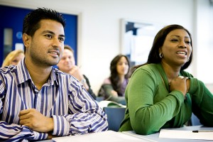 A pair of adult learners engaged in a lesson. (iStock Photo)