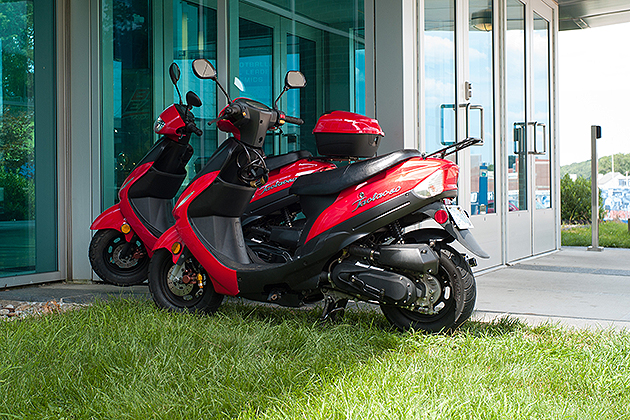 Scooters parked outside the entrance to the Burton Family Football Complex on Aug. 22, 2012. (Peter Morenus/UConn Photo)