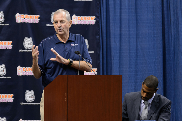 Jim Calhoun, left, speaks at a press conference held at Gampel Pavilion to announce his retirement and the appointment of Kevin Ollie as head men's basketball coach on Sept. 13, 2012. (Peter Morenus/UConn Photo)