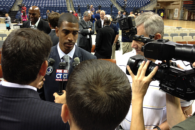Kevin Ollie, UConn's new men's basketball head coach, speaks with reporters after the press conference. (Peter Morenus/UConn Photo)