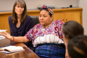Rigoberta Menchú Tum, center, speaks with students. At left is Anne Gebelein, associate director of El Instituto. (Peter Morenus/UConn Photo)