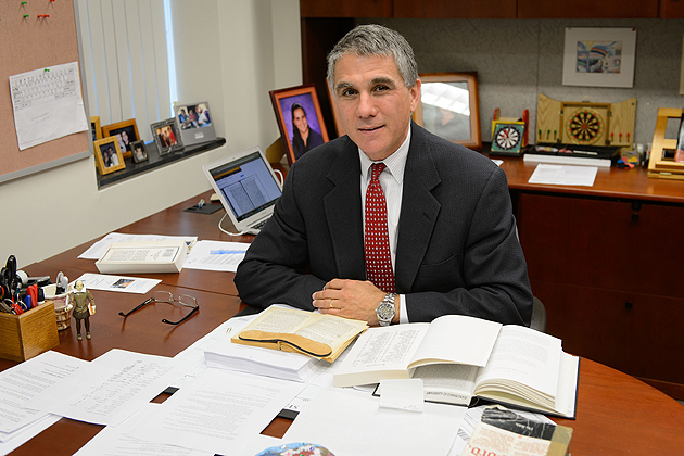 Jeffrey Shoulson, the Doris and Simon Konover Chair in Judaic Studies at his office on Sept. 13, 2012. (Peter Morenus/UConn Photo)